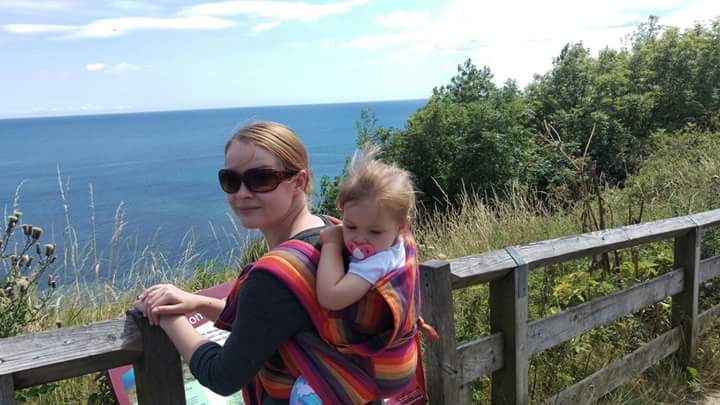 babywearing on the coast line