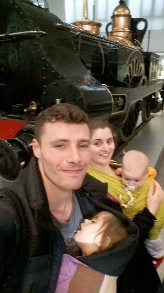 babywearing family at york transport museum
