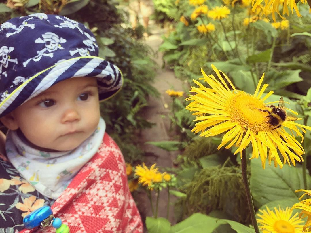 Baby at Wentworth garden centre with flowers 40+ Easy Outdoor Nature Play Ideas For Toddlers