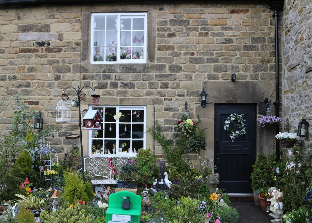 Eyam plague village in the Peak District and national trust Eyam Hall plague cottage